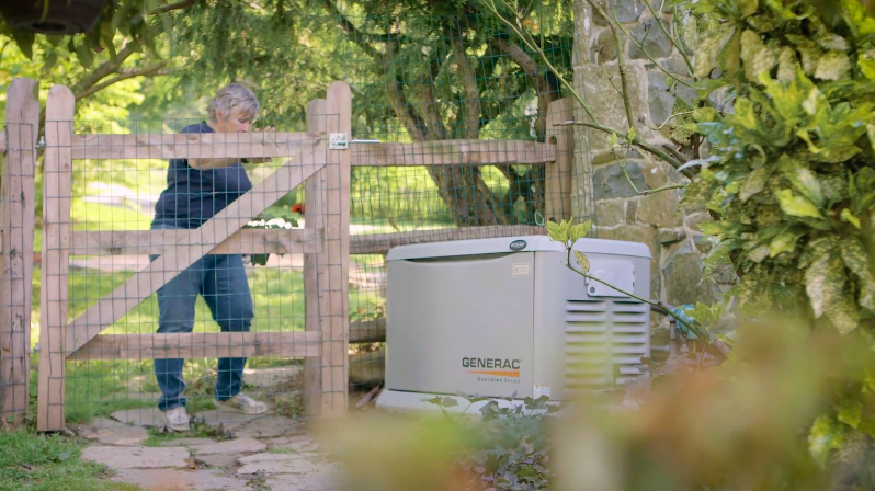 Woman Checking On Her Generac Standby Generator