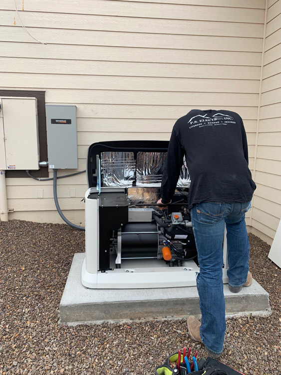 ps-electric-technician-installing-standby-at-home-generac-generator-in-prescott-valley