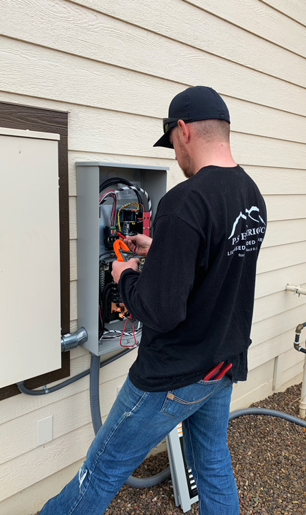 PS Electric Generac Generator Service Technician Working On Generac Generator Electrical Panel in Prescott, AZ